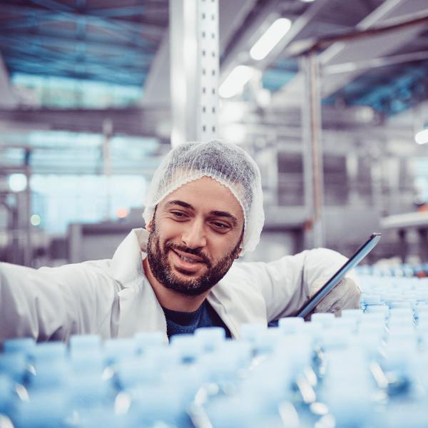 Employee looking at production line in Lifestyle nutrition factory