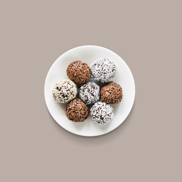 Seven protein fortified food balls on a white plate