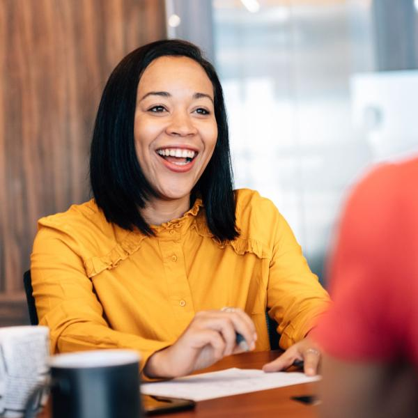 interview candidate smiling back at interviewer